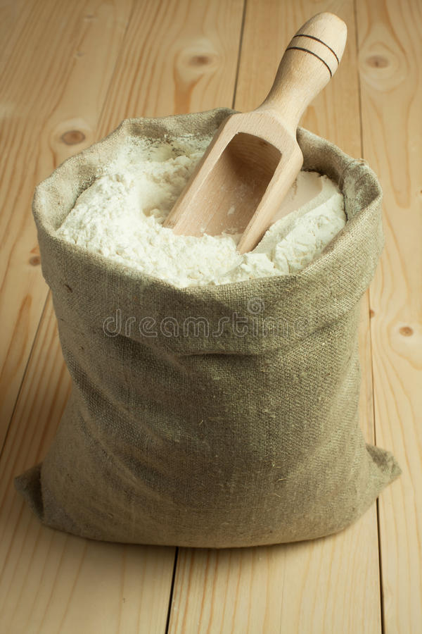 Flour in canvas bag royalty free stock photography