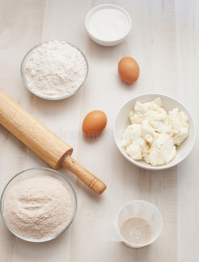 Flour with eggs, ricotta cheese and rolling pin royalty free stock photo