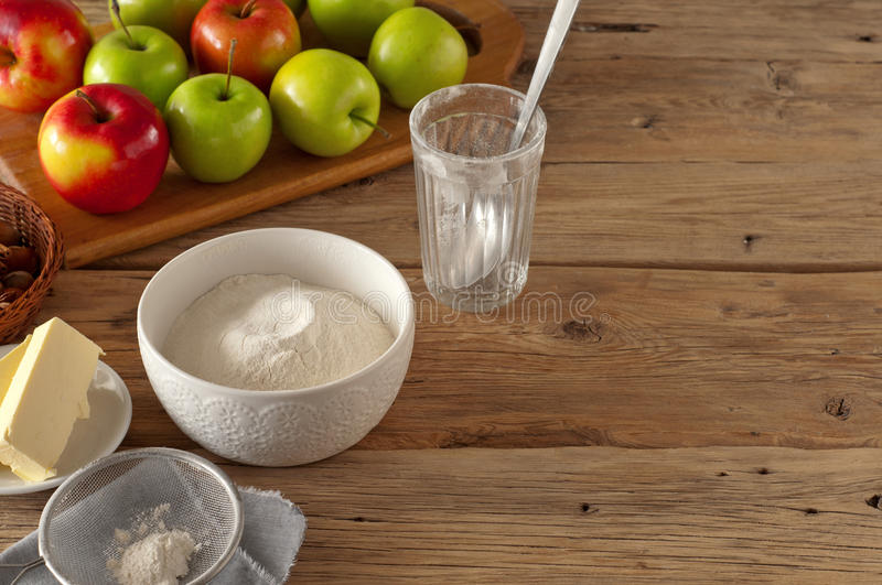 Flour with ingredients for cooking bakery products with apples stock photography