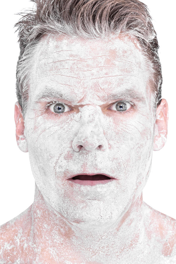 Flour man. Closeup portrait of surprised face of Caucasian man covered in bleached white flour on white background