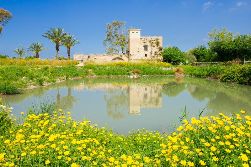 Flour Mill, En Afek. A restored Crusader-era flour mill building, and a water pond, in En Afek Nature Reserve, northern Israel royalty free stock photography