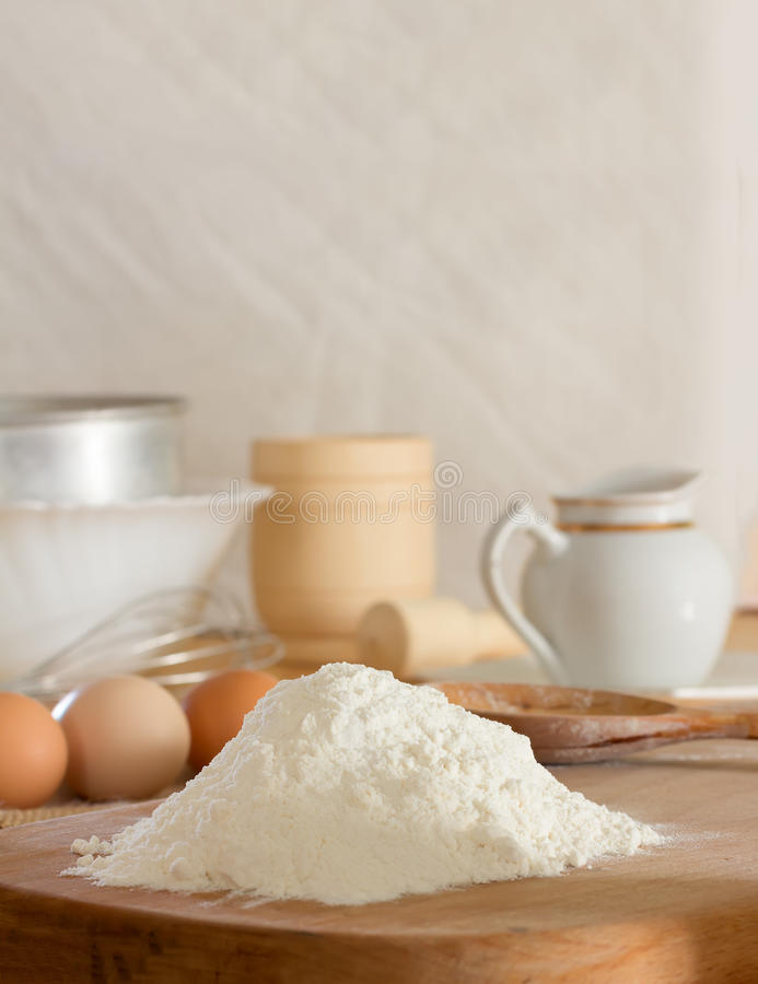 Flour and raw chicken eggs royalty free stock photography