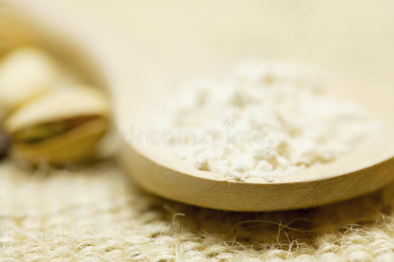 Flour in a spoon royalty free stock photography