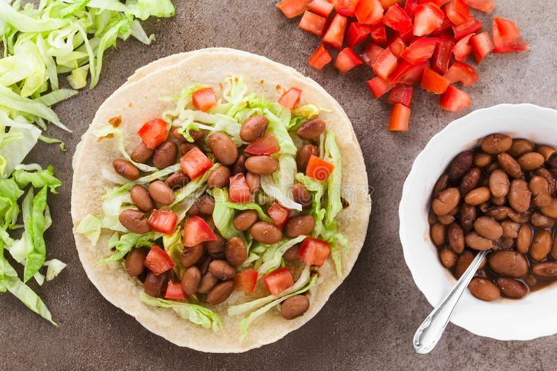 Flour Tortilla with Bean, Tomato and Lettuce royalty free stock photos