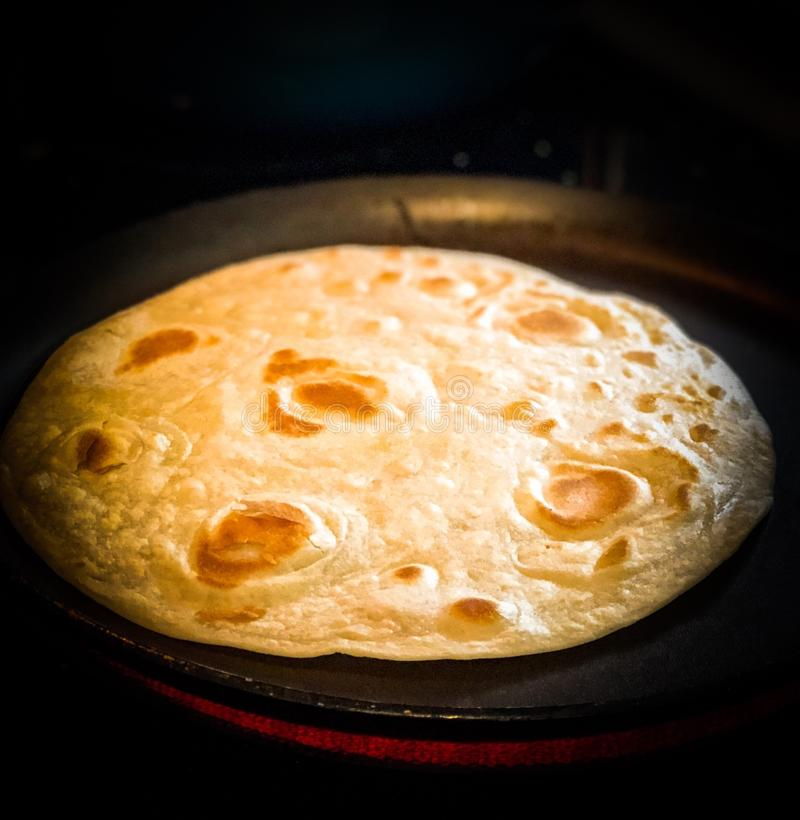 Flour Tortilla Being Cooked on Comal stock photography