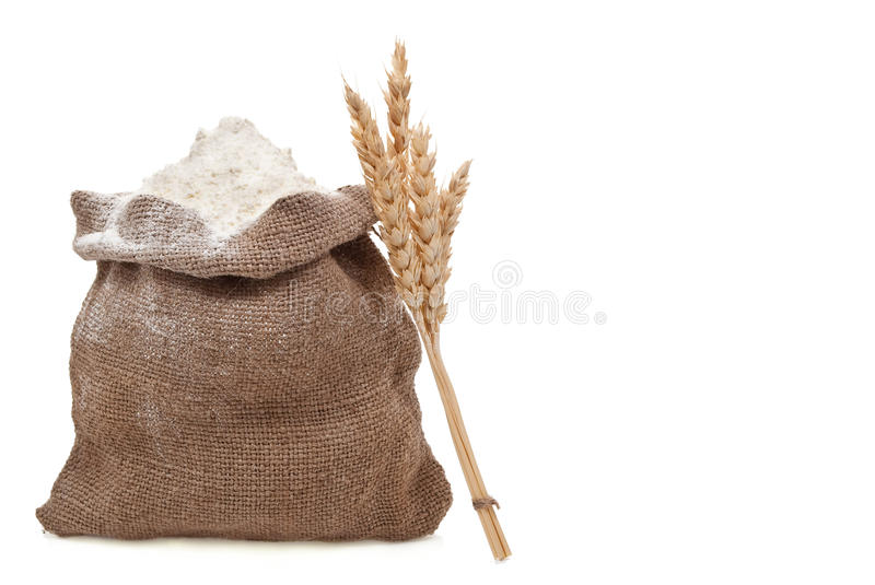 Flour and wheat ears stock photo