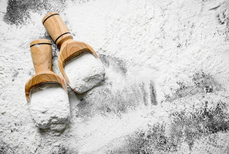 Flour in wooden scoops stock photography