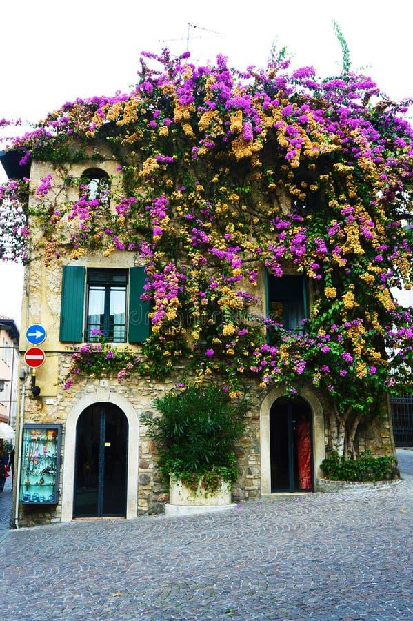 Flourished house in Sirmione, Garda Lake, Italy. Beautiful flourished house in Sirmione, Garda Lake, Italy royalty free stock photos