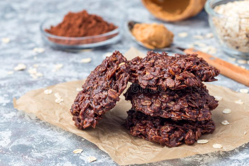 Flourless no bake peanut butter and oatmeal chocolate cookies on  parchment, horizontal. Flourless no bake peanut butter and oatmeal chocolate cookies stock images
