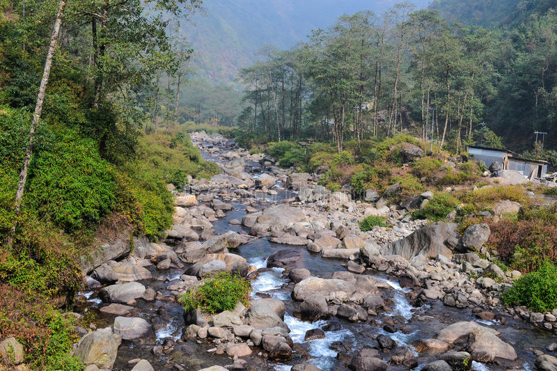 Flow lke water. A river flowing inindia darjeling stock photos