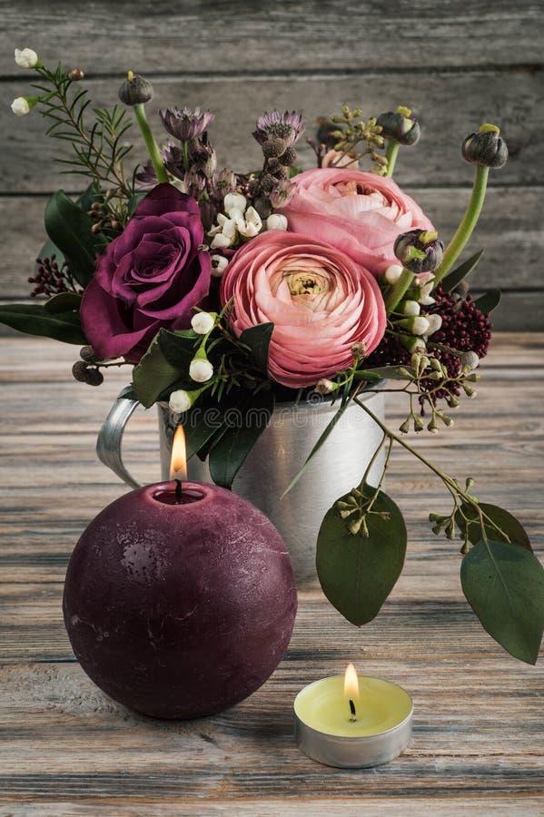 Flower arangement of roses and ranunculus stock photos