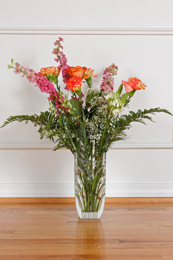 Flower Arrangement. A beautiful bouquet of flowers in a crystal vase royalty free stock photography