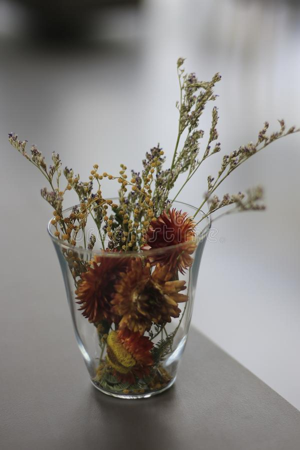 Flower arrangement in clear glass royalty free stock photo