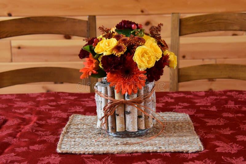 Flower Arrangement. Fall flower arrangement on table stock images