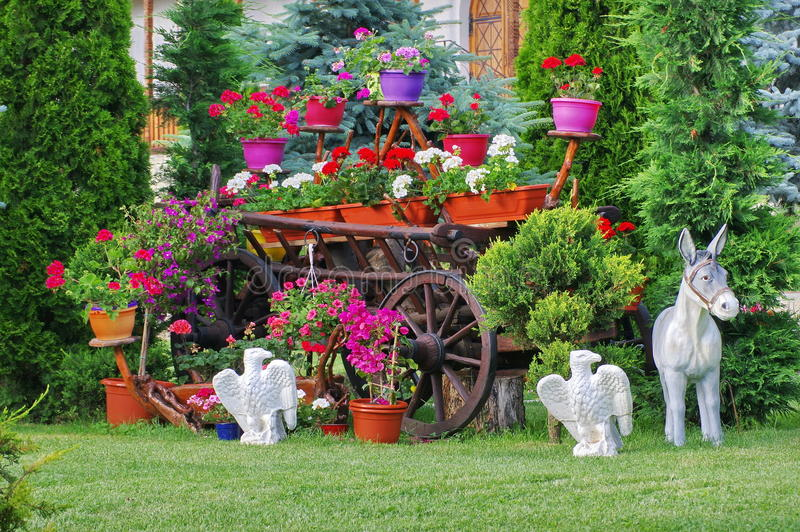 Flower arrangement in the garden of Monastery Bujoreni, landmark attraction in Romania. Spring landscape royalty free stock image