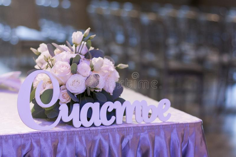 Flower arrangement in pastel colors is on the festive table royalty free stock photos