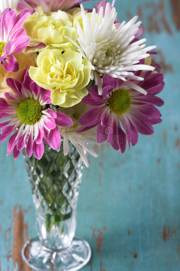 Flower Arrangement of Pink white and yellow flowers. Bouquet of Pink white and yellow flowers in vase on rustic table stock photography