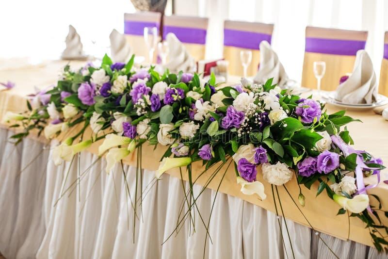 Flower arrangement on the table purple and white flowers the c download flower arrangement on the table purple and white flowers the c stock photo mightylinksfo