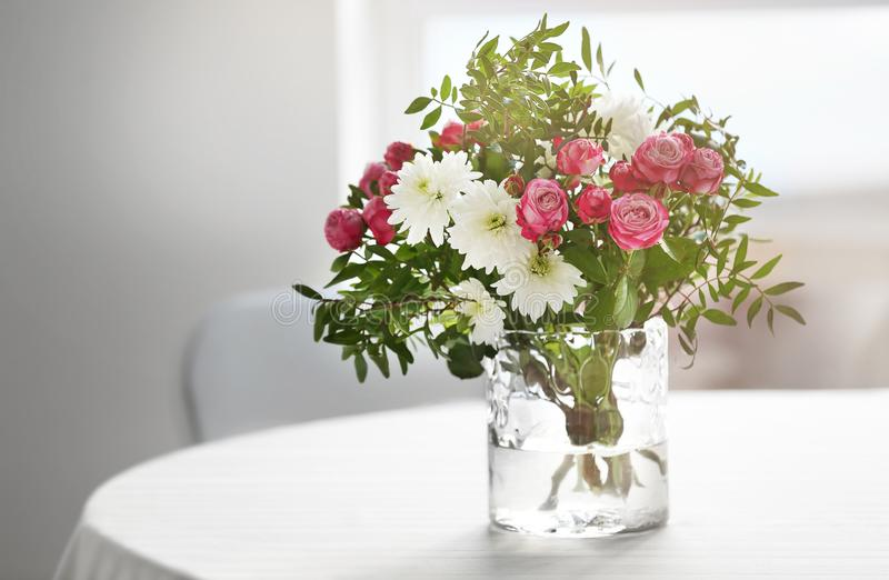 Flower arrangement on a table stock photos