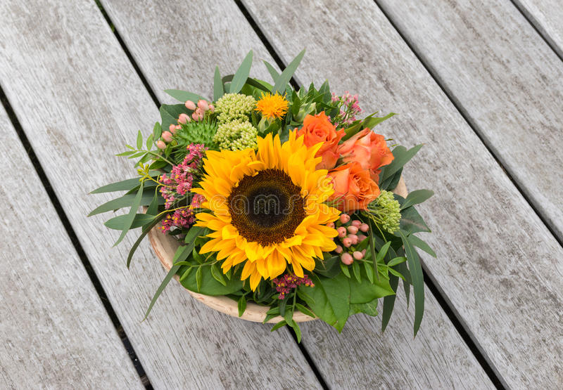 Flower arrangement on wooden table. stock photo