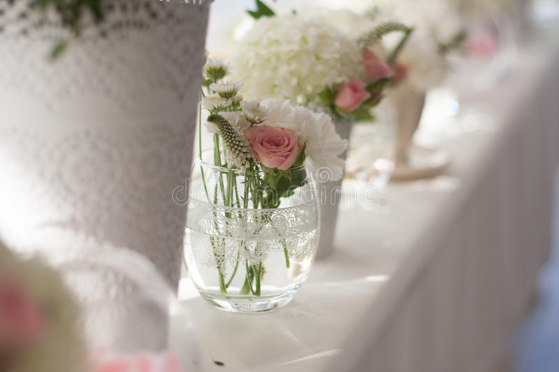 Flower arrangements. On the table in a cafe royalty free stock photo
