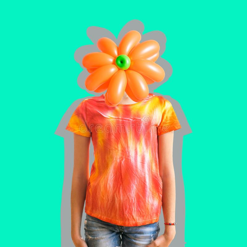 Flower of balloons on the head of a child dressed in the style of tie dye. Contemporary art collage. stock image