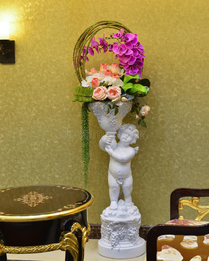 Flower basket and child sculpture royalty free stock photography