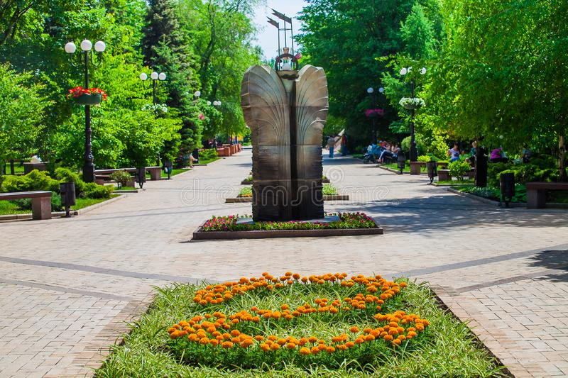 Flower bed and decorative statue in urban public place in Donetsk royalty free stock images