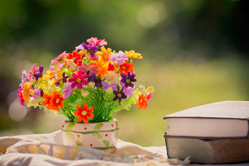 Flower and book at nature stock photo