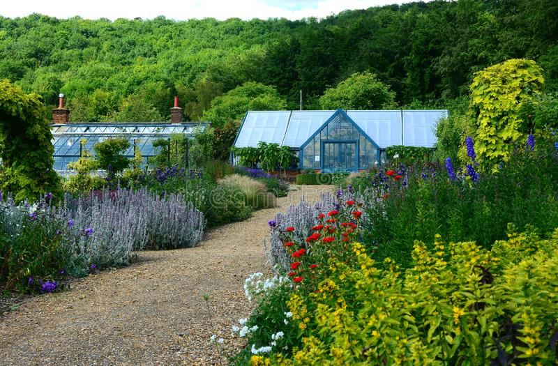 Flower borders in bloom and greenhouse royalty free stock images