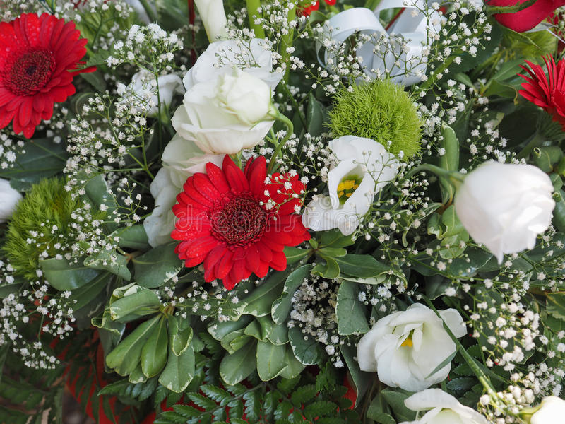 Flower bouchet. With red daisies and white roses stock image