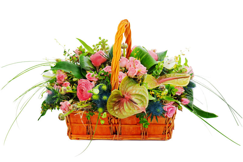 Flower bouquet arrangement centerpiece in a wicker gift basket. Isolated on white background royalty free stock photos