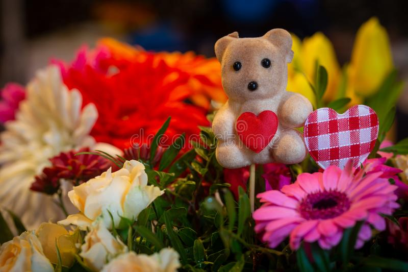 Flower bouquet decoration with teddy bear royalty free stock images