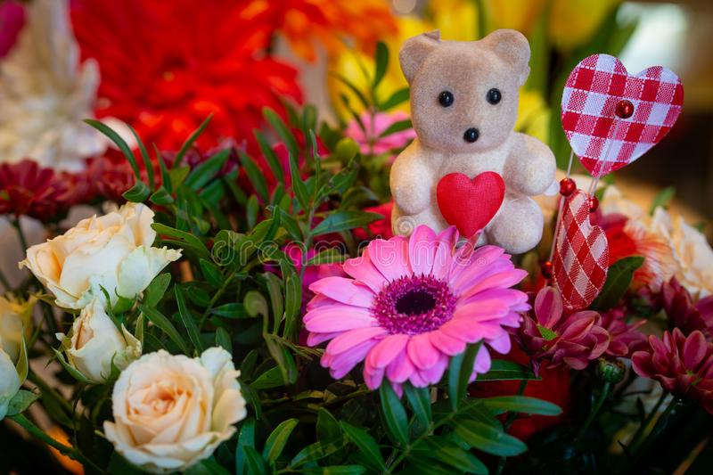 Flower bouquet decoration with teddy bear stock photo