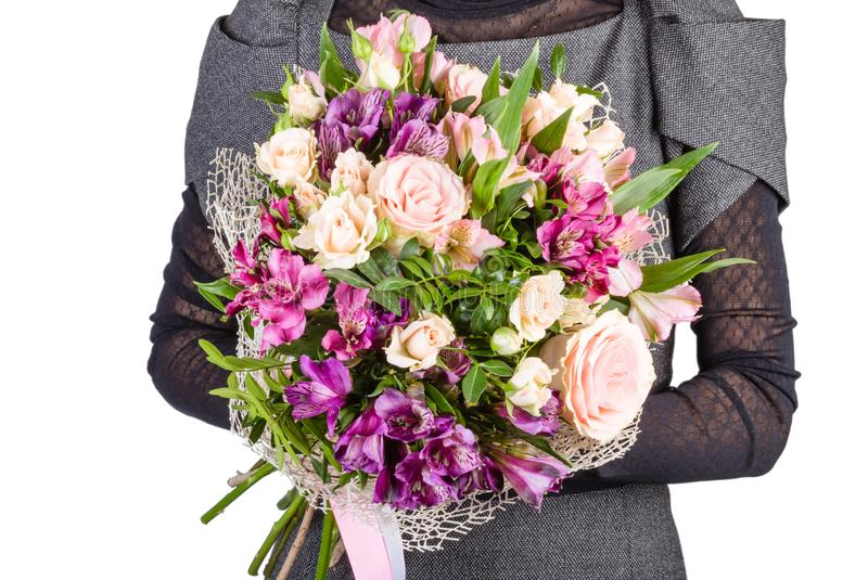 Flower bouquet in the hands of the girl.  royalty free stock image