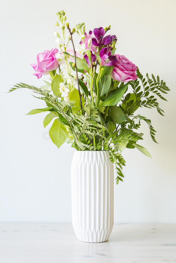 Flower bouquet in white vase stock images