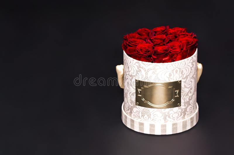 Flower box intended for home decor, weddings, anniversaries, birthdays and other celebrations. Red roses. Also could be a very special gifts for your partner stock photos