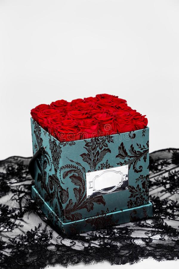 Flower box intended for home decor, weddings, anniversaries, birthdays and other celebrations. Red roses. Also could be a very special gifts for your partner royalty free stock photography