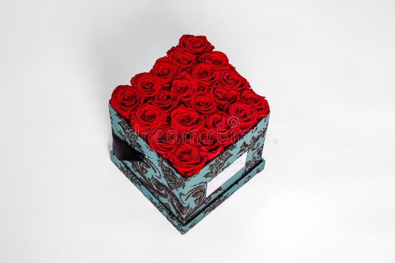 Flower box intended for home decor, weddings, anniversaries, birthdays and other celebrations. Red roses. Also could be a very special gifts for your partner royalty free stock images