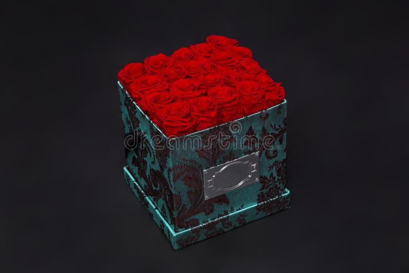 Flower box intended for home decor, weddings, anniversaries, birthdays and other celebrations. Red roses. Also could be a very special gifts for your partner royalty free stock image