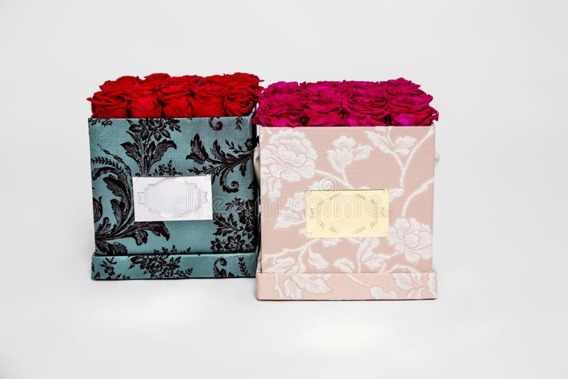 Flower box intended for home decor, weddings, anniversaries, birthdays and other celebrations. Red roses. Also could be a very special gifts for your partner stock photo