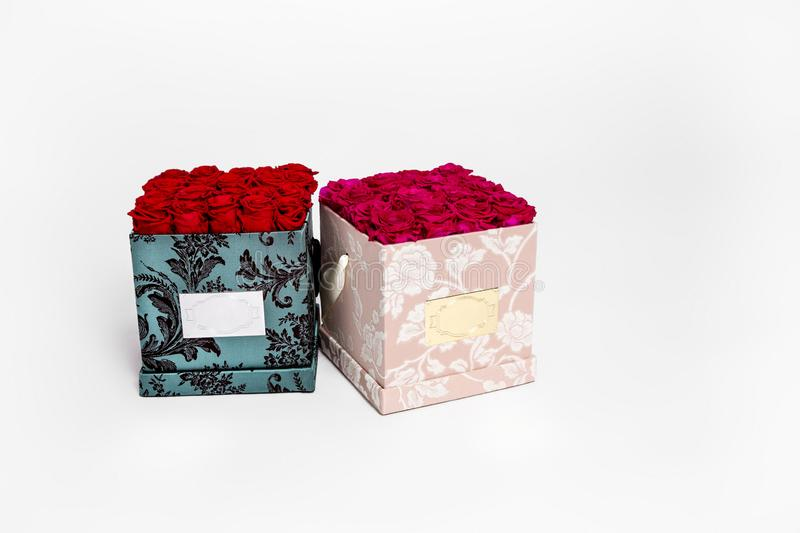 Flower box intended for home decor, weddings, anniversaries, birthdays and other celebrations. Red roses. Also could be a very special gifts for your partner stock photography
