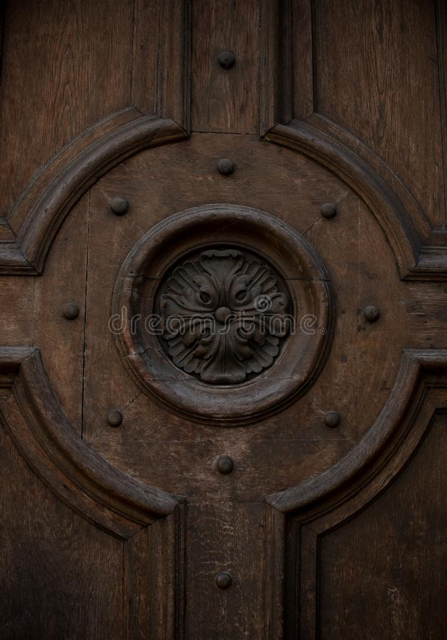The flower is carved on wooden doors royalty free stock photo