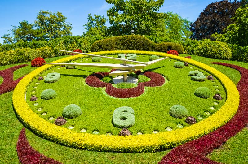 Flower clock in Geneva, Switzerland. L`horloge fleurie in French, outdoor flower clock located on the western side of Jardin stock photography