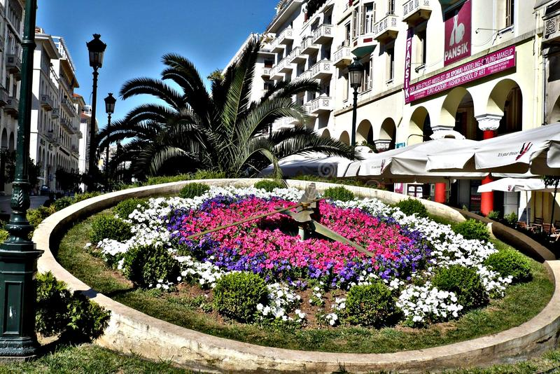 Flower clock in Thessaloniki. Flower clock thessaloniki interesting greece nice weather building tree flowers white green history sea harbor  goos goodday stock images