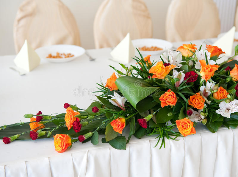 Flower composition. Made with orange roses and red gillyflower royalty free stock photography