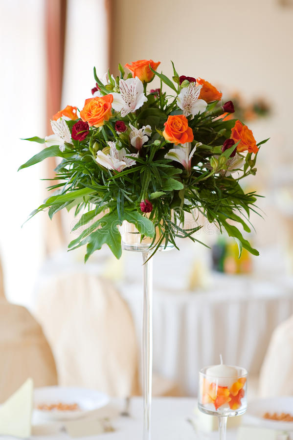 Flower composition. Made with orange roses and red gillyflower royalty free stock photos