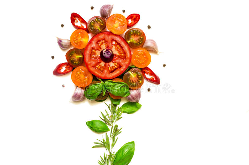 Flower concept made with healthy fresh tomatoes, vegetables, herbs and spices stock photo