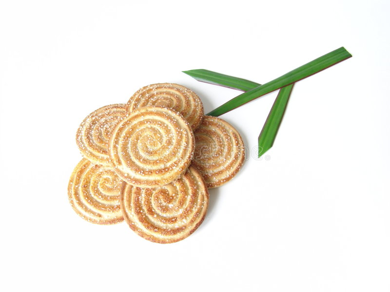 Flower-cookie. Flower made from spiral cookies and natural leafs royalty free stock image