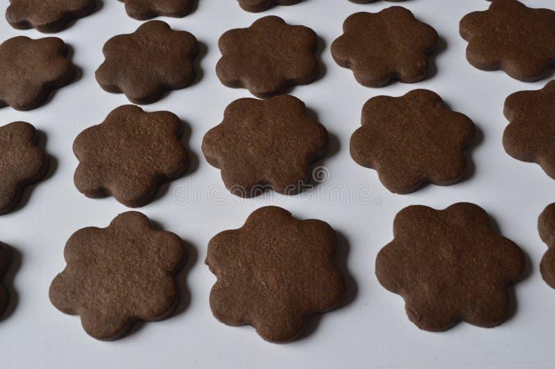 Flower cookies. Homemade dark chocolate flower shaped cookies stock photo